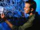 Technician Adjusting Wires on Server